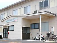 社屋は出雲平野の中央、電鉄川跡駅の横にある。